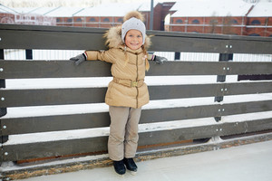 Young girl on skates spending time on ice-rink
