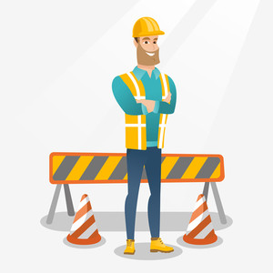 Young smiling builder standing with arms crossed. Confident builder in hard hat. Caucasian builder in helmet standing on the background of road barriers. Vector flat design illustration. Square layout