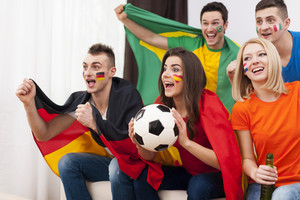 Young soccer fans during the watching match on TV