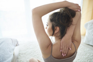 Young woman stretching at the morning time
