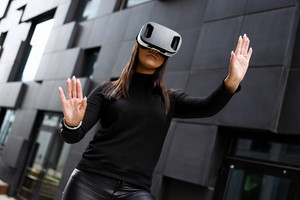 Young Woman Wearing Virtual Reality Glasses And Black Clothes In Futuristic City