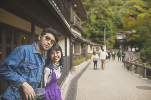 younger asian man and woman traveling with happiness in japan destination