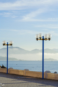 Street light against sea and mountain background