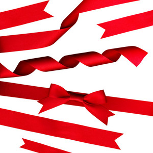 Strips Of Red Shiny Ribbon And A Bow Over A White Background With Clipping Path