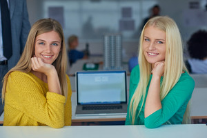 Student girls together in classroom