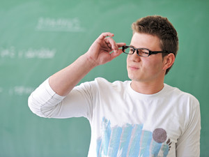Student with glasses in classroom