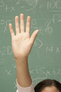 Student's hand raised in classroom
