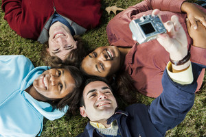 Students laying on grass