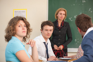 Students posing in a classroom durign a lecture