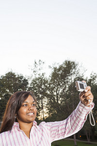 Students taking photographs on campus