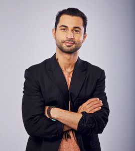 Studio shot of a confident casual middle eastern guy
