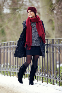 Stylish Female Walking in a Winter Park