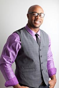 Stylish modern business man wearing black framed glasses.