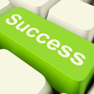 Success Computer Key In Green Showing Achievement And Determination