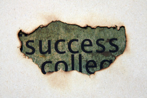 Success Text On Paper Hole