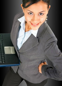 Successful Business Woman Using A Notebook Computer