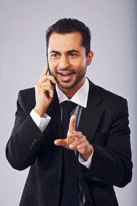 Successful businessman having a phone conversation