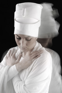 Sufi female dancing, white on black, motion blur