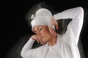 Sufi female dancing, white on black, motion blur