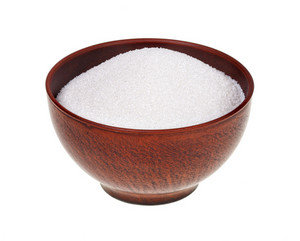 Sugar in the clay bowl isolated on white