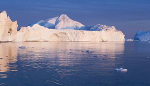 Sunlit iceberg against a blue sky