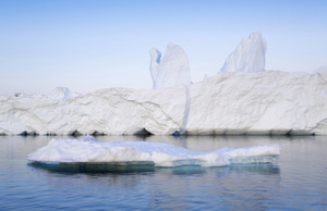 Sunlit iceberg and ice floe