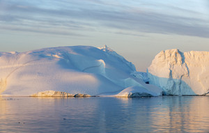 Sunlit iceberg at dusk