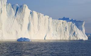 Sunlit iceberg in rippled water