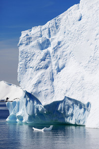 Sunlit iceberg under a blue sky
