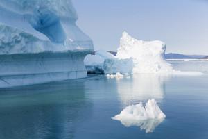 Sunlit icebergs along the coast