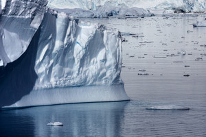 Sunlit icebergs in icy waters