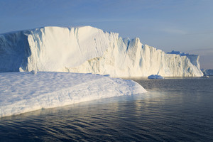 Sunlit icebergs in rippled water