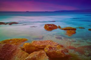 Sunrise over a rocky coast