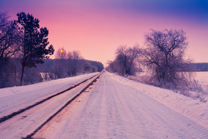 Sunrise over snowy road
