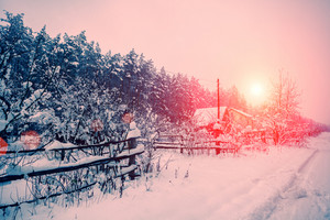 Sunrise over snowy village