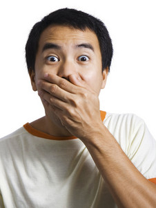 Surprised And Shocked Guy Covering Mouth