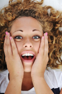 Surprised excited young woman