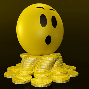 Surprised Smiley With Coins Shows Unexpected Earnings