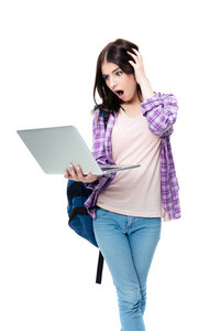 Surprised woman standing and looking on laptop screen