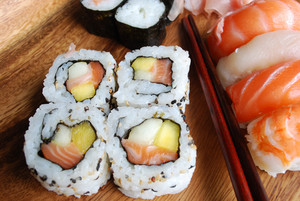 Sushi - Japonese Food (on A Wooden Plate)