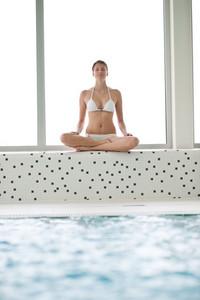 Swimming pool - beautiful woman wearing bikini,relax by pool
