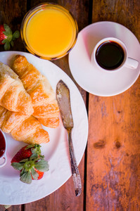 Tasty Breakfast:coffee With Croissants