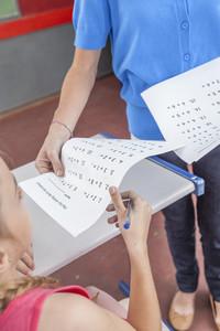 Teacher giving the exam