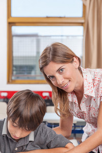 Teacher helping a boy