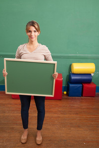 teacher holding a blackboard