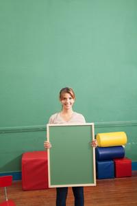 teacher holding a blackboard