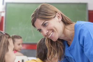 Teacher looking at pupil