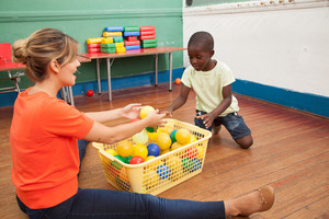 Teacher playing with a little student