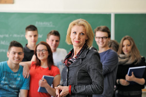 Teacher standing in front of smiling students