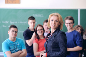 Teacher standing with her students in a background
